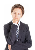Thinking. Boy in white shirt, tie and Jacket looking to the side having a thoughtful look Stock Photography