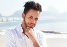 Thinking brazilian man at Copcacabana beach at Rio de Janeiro Royalty Free Stock Photos