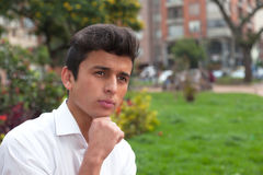 Thinking brazilian student in a park Stock Photography