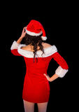 Thinking brunette in santa outfit posing with hand on hip Stock Image