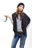 Thinking brunette woman in cap Royalty Free Stock Photos