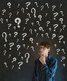 Thinking business man with chalk question marks Stock Images