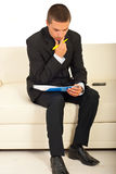 Thinking business man on couch Stock Photo