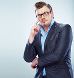 Thinking Business man funny portrait. Isolated. Royalty Free Stock Image