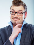 Thinking Business man funny portrait. Isolated. Stock Photography