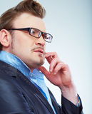 Thinking Business man funny portrait. Isolated. Stock Photo