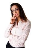 Thinking business woman. Beautiful smart successful Caucasian Hispanic entrepreneur business woman standing, wearing dark blue pants, pink shirt and glasses Stock Photos
