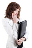 Thinking business woman with a leather case Stock Images