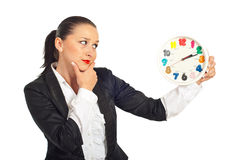 Thinking business woman looking at clock Stock Images