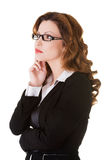Thinking business woman looking up. Royalty Free Stock Photos