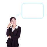 Thinking business woman looking up on speech empty bubble royalty free stock photos