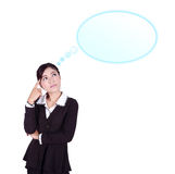 Thinking business woman looking up on speech empty bubble Royalty Free Stock Photography