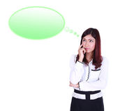 Thinking business woman looking up on speech empty bubble Stock Image