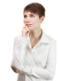 Thinking business woman smiling looking up Stock Image