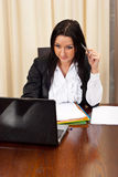 Thinking business woman working Royalty Free Stock Images