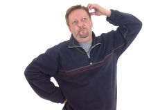 Thinking businessman. Middle aged thinking businessman, casual dressed, studio shot Royalty Free Stock Photo
