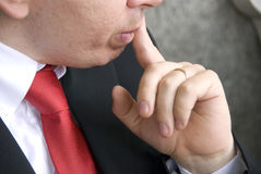 Thinking businessman. Thinking young businessman in red tie Stock Photo