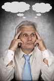 Thinking. Businessman contemplating over ideas on silver background Royalty Free Stock Photos