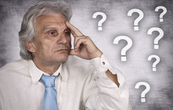 Thinking. Businessman contemplating over ideas on silver background Stock Images