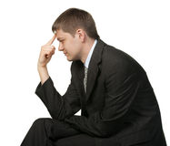 The thinking businessman.Finger at a forehead Royalty Free Stock Photo
