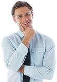 Thinking businessman with hand on chin Stock Photo