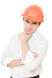 Thinking businessman in the helmet. Royalty Free Stock Photos