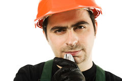 Thinking businessman in the helmet. Royalty Free Stock Photography