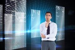 Thinking businessman holding glasses Stock Images