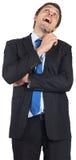 Thinking businessman holding pen Stock Photos