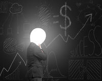 Thinking businessman with lamp head illuminated dark business do Stock Images