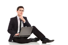 Thinking businessman with laptop. stock photos