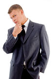 Thinking businessman looking at camera Stock Image