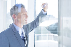 Thinking businessman. In the office royalty free stock photography