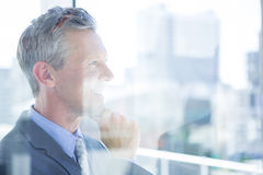 Thinking businessman in the office Stock Images