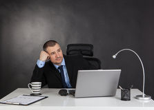 Thinking businessman in office. Stock Image