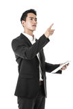Thinking Businessman pointing with a tablet on hand Stock Images