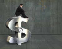 Thinking businessman sitting on silver dollar sign with lock Stock Photography