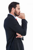 Thinking businessman standing with hand on chin Royalty Free Stock Photography