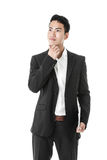 Thinking Businessman with a tablet Stock Images