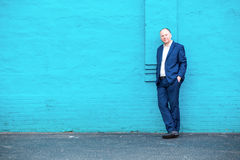 Thinking businessman and turquoise wall Royalty Free Stock Photos