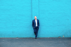 Thinking businessman and turquoise wall Stock Photo