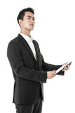 Thinking Businessman using a tablet Stock Photos
