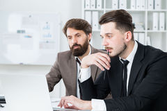 Thinking businesspeople discussing project Stock Photos