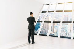Thinking businessperson room city Stock Image