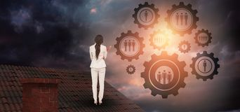 Composite image of thinking businesswoman. Thinking businesswoman against gloomy sky royalty free stock photography