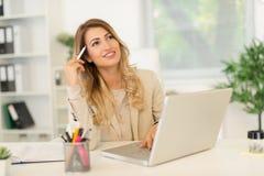 Thinking Businesswoman Royalty Free Stock Photos