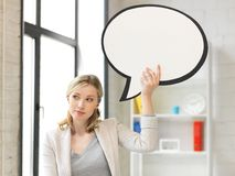 Thinking businesswoman with blank text bubble Stock Images