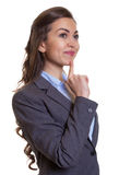 Thinking businesswoman with brown hair Stock Image