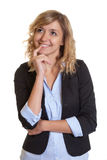 Thinking businesswoman with curly blond hair Royalty Free Stock Photo