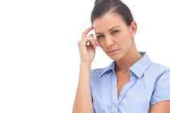 Thinking businesswoman with hand on head Stock Image